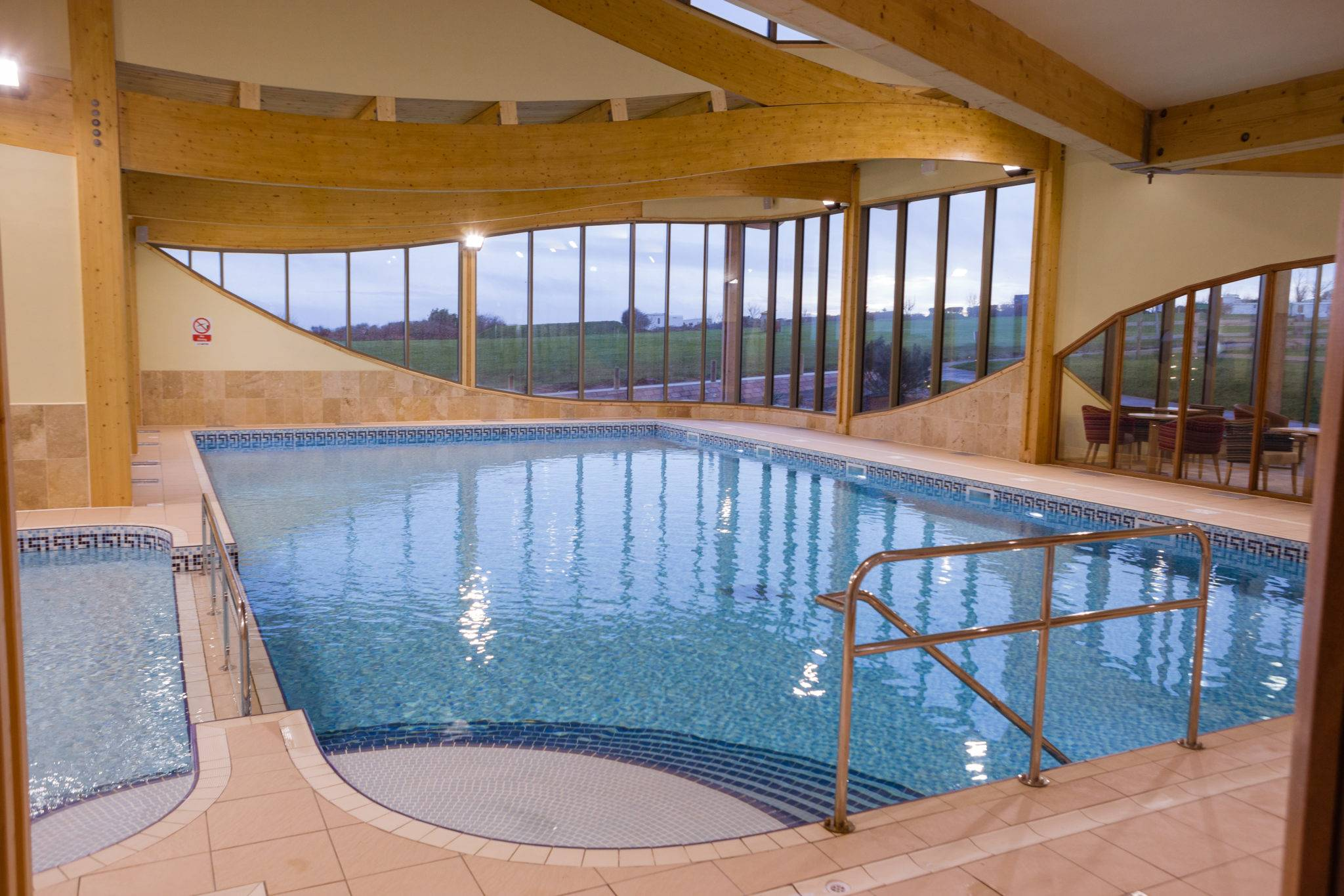 https://silverbay.co.uk/wp-content/uploads/2015/01/silver-bay-holiday-village-anglesey-two-swimming-pools.jpg