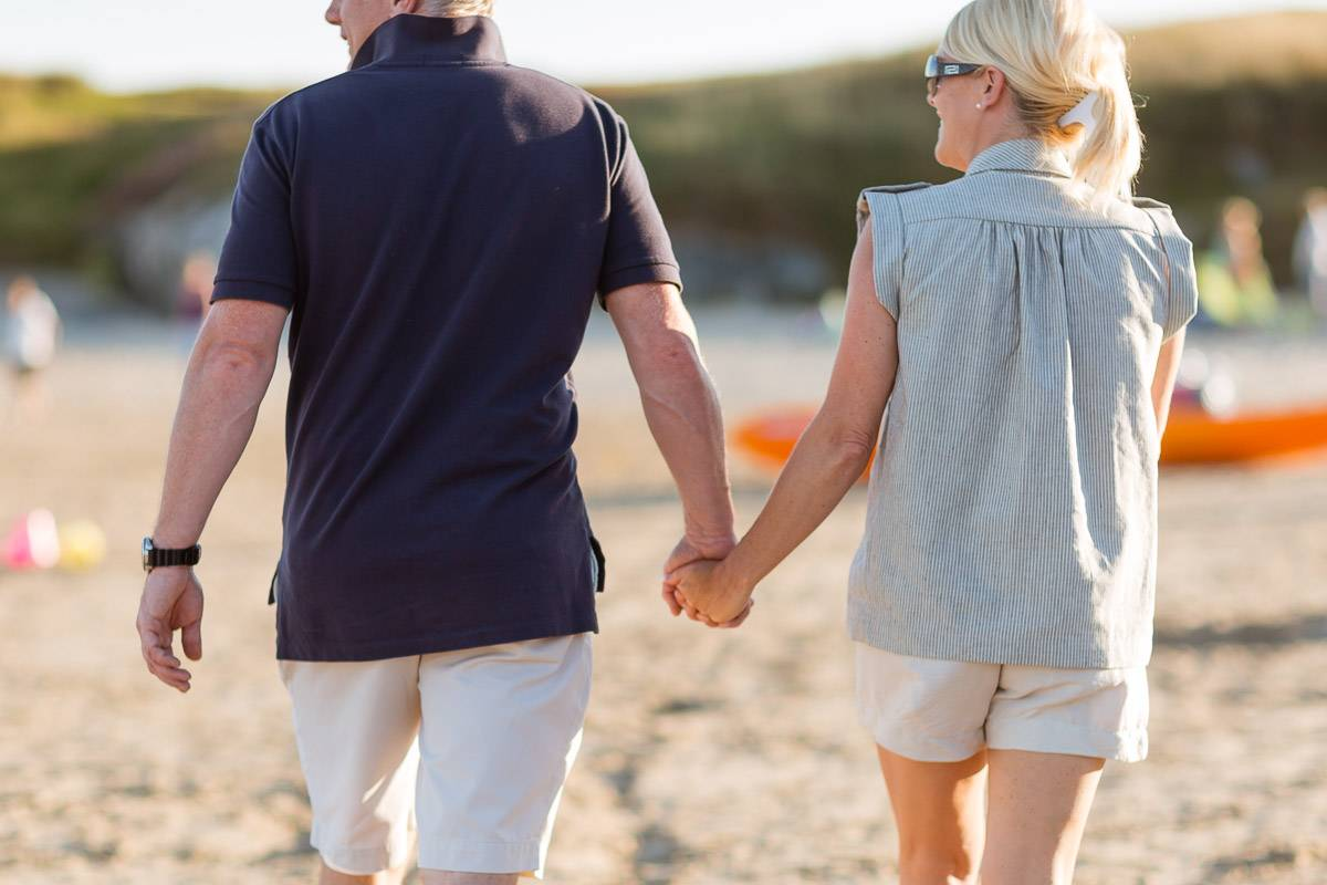 silver-bay-holiday-village-anglesey-beach-hand-holding