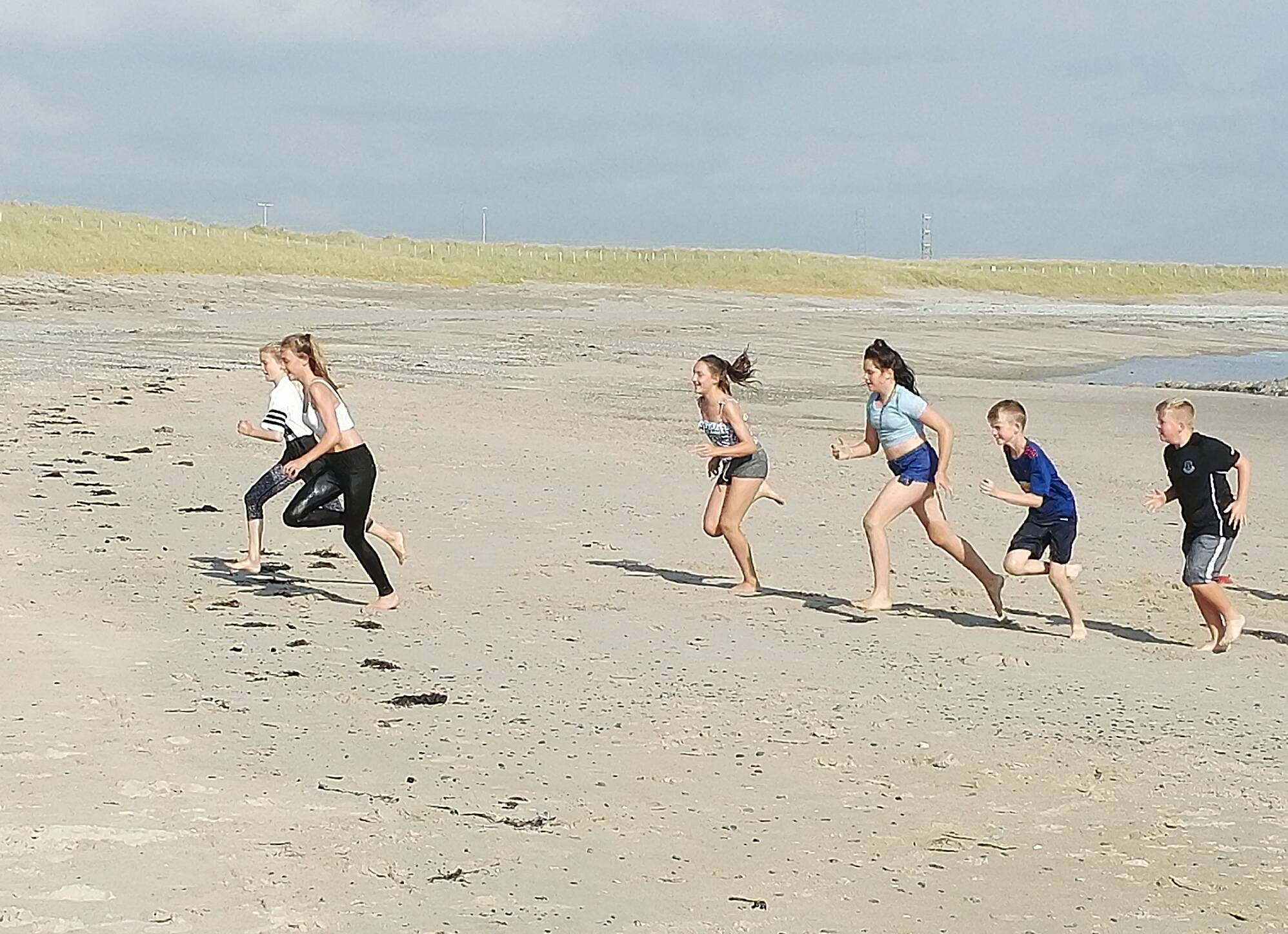 silver-bay-holiday-village-anglesey-busy-bayer-beach-running.