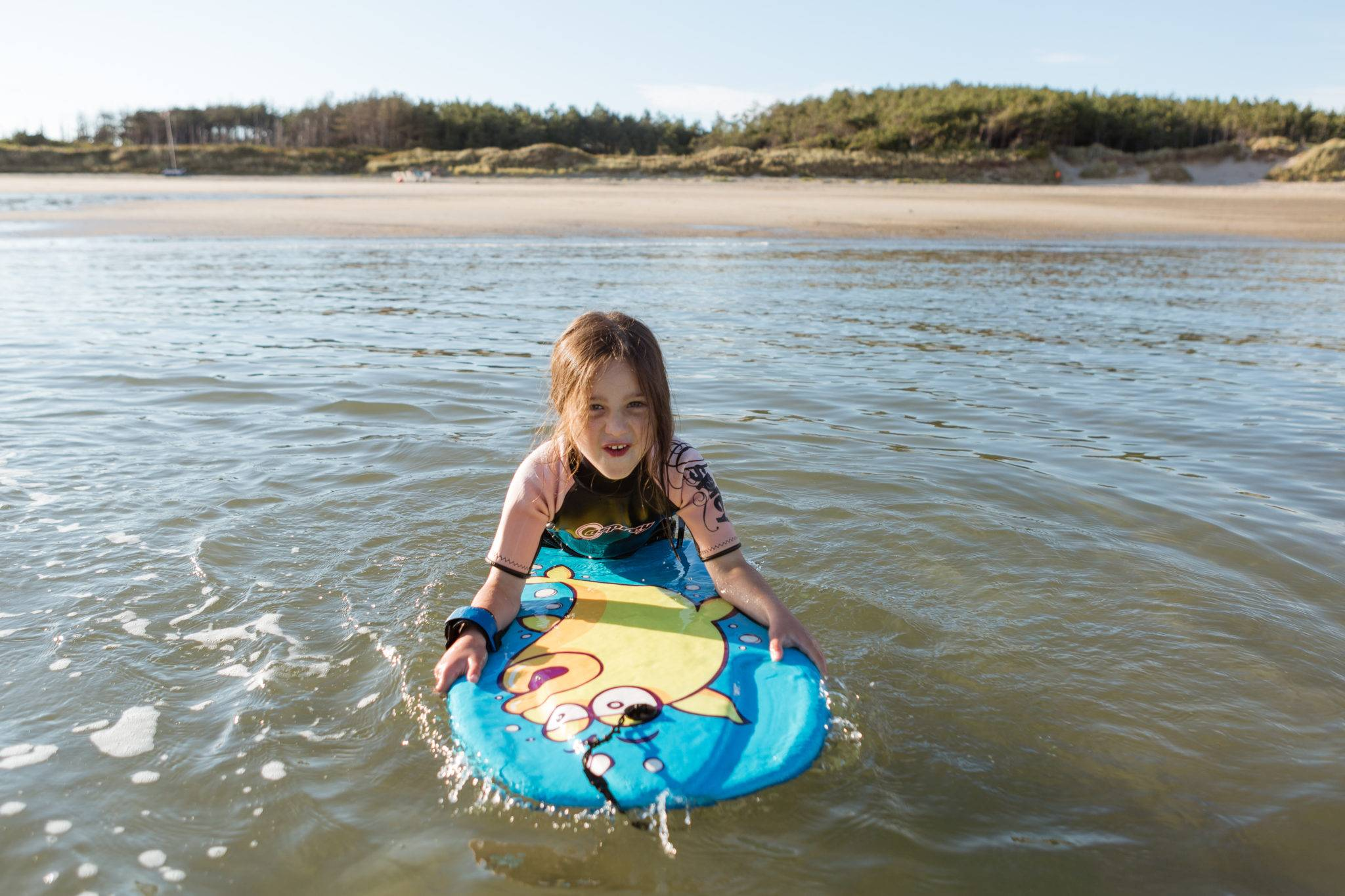 silver-bay-holiday-village-anglesey-busy-bayers-bodyboard-fun-girl-ocean-beach