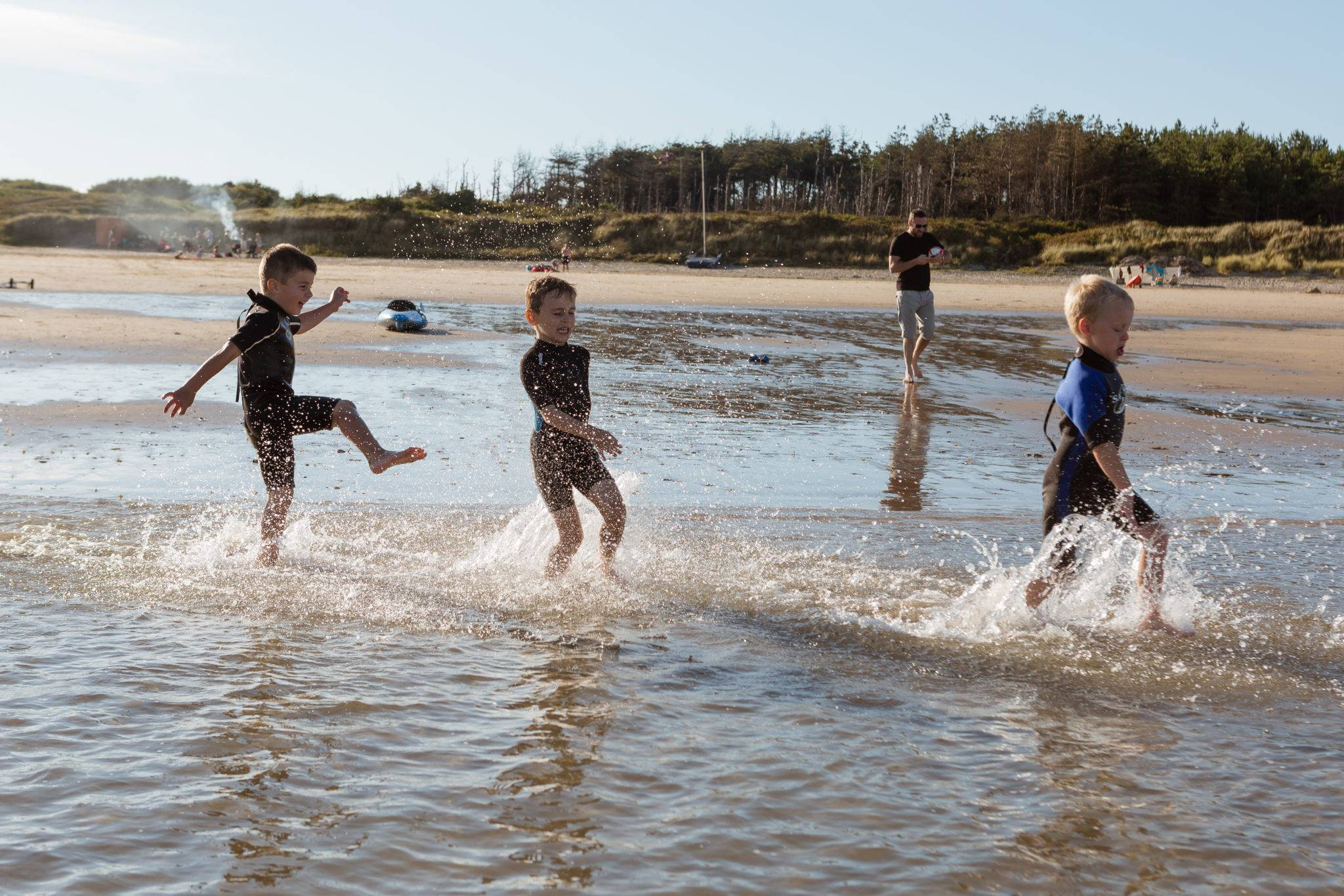 silver-bay-holiday-village-anglesey-busy-bayers-boys-playing-ocean-water