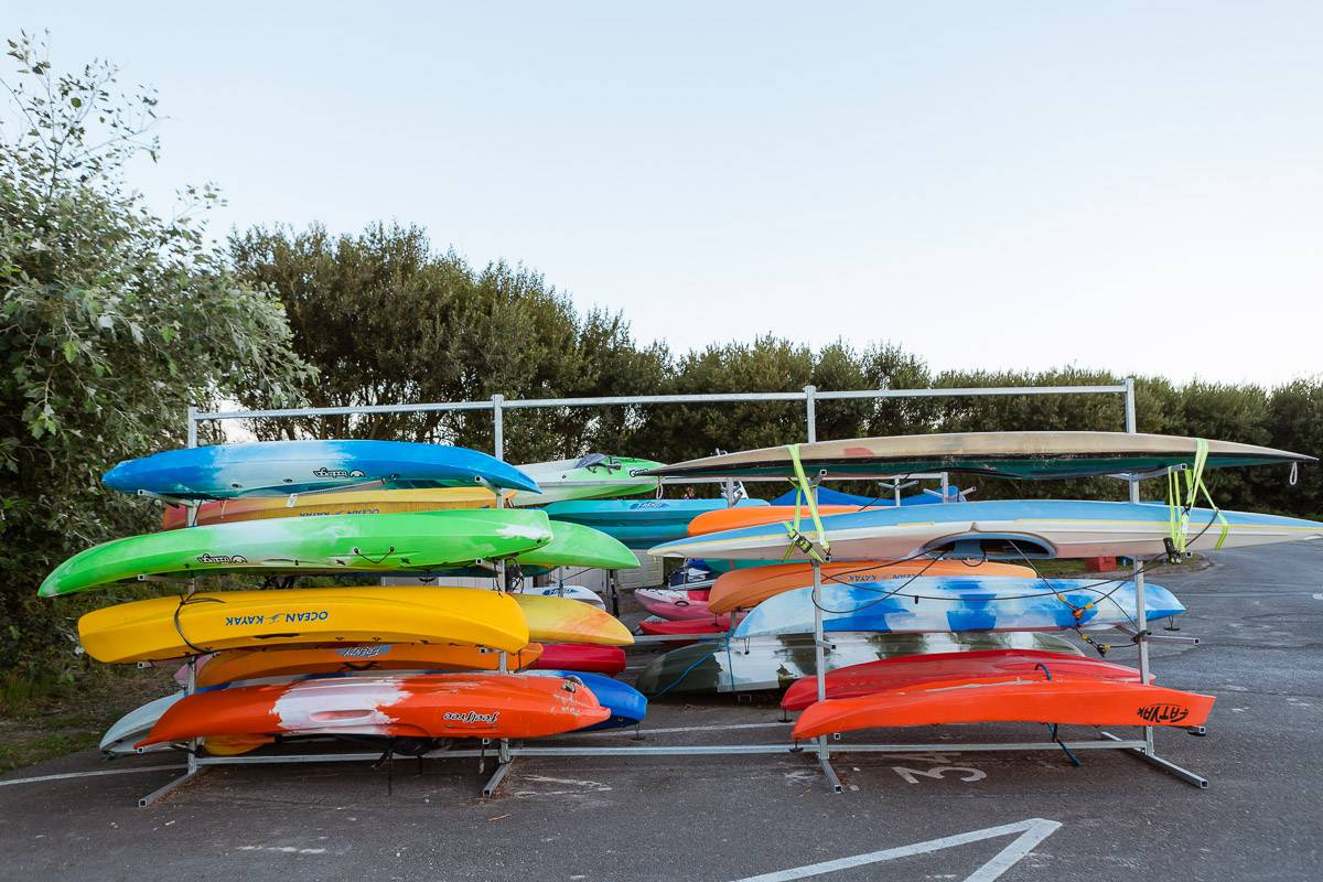 silver-bay-holiday-village-anglesey-lots-coloured-canoes