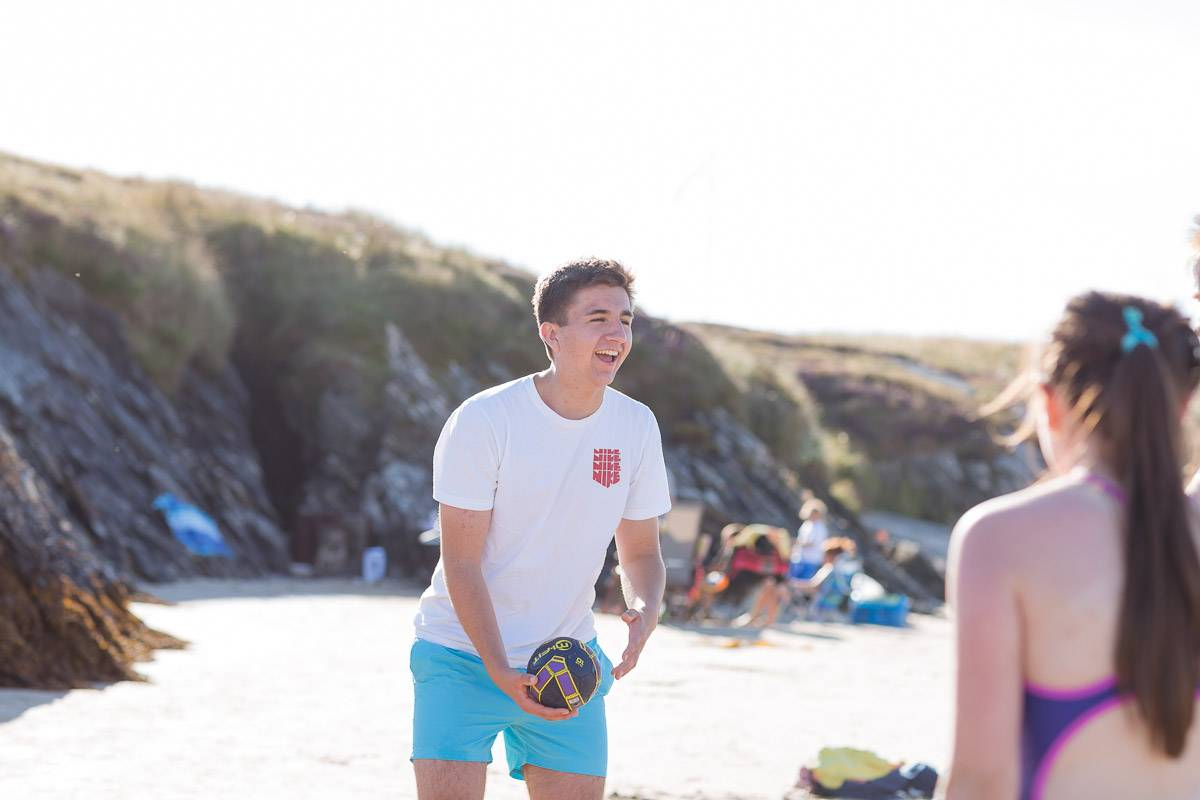 silver-bay-holiday-village-anglesey-man-playing-volley-ball-on-silver-bay