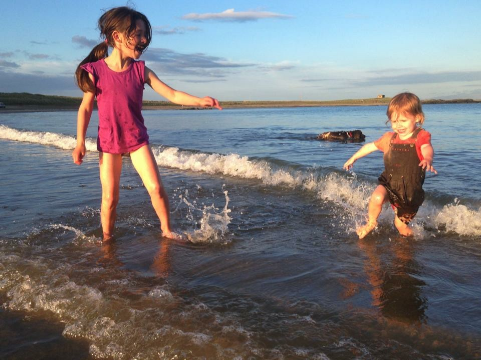silver-bay-holiday-village-anglesey-siblings-beach-paddling.jpeg