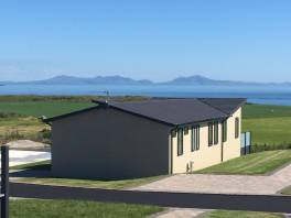 http://silverbay.co.uk/wp-content/uploads/2016/12/silver-bay-holiday-village-luxury-lodges-anglesey-headland-rise-beautiful-views.jpg