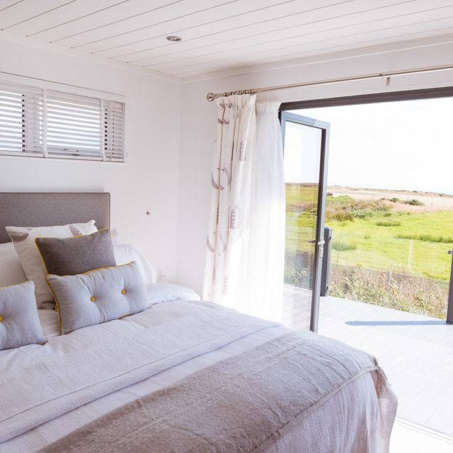 http://silverbay.co.uk/wp-content/uploads/2016/12/silver-bay-holiday-village-luxury-lodges-anglesey-headland-rise-shearwater-lodge-640x640.jpg