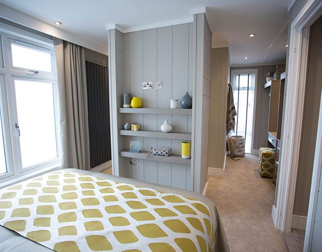 http://silverbay.co.uk/wp-content/uploads/2016/12/silver-bay-holiday-village-luxury-lodges-anglesey-vista-dressing-room-bedroom-640x500.jpg