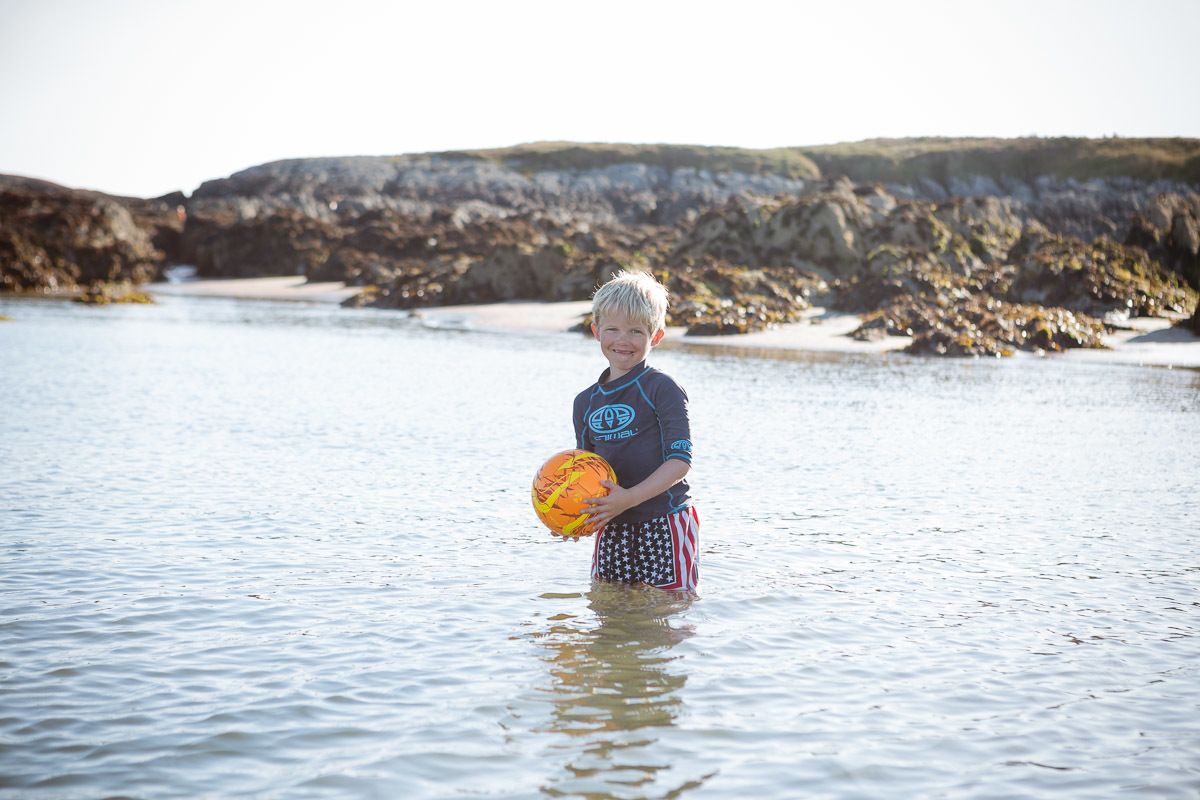 1500563675324-silver-bay-holiday-village-anglesey-young-boy-in-ocean-with-ball.jpg