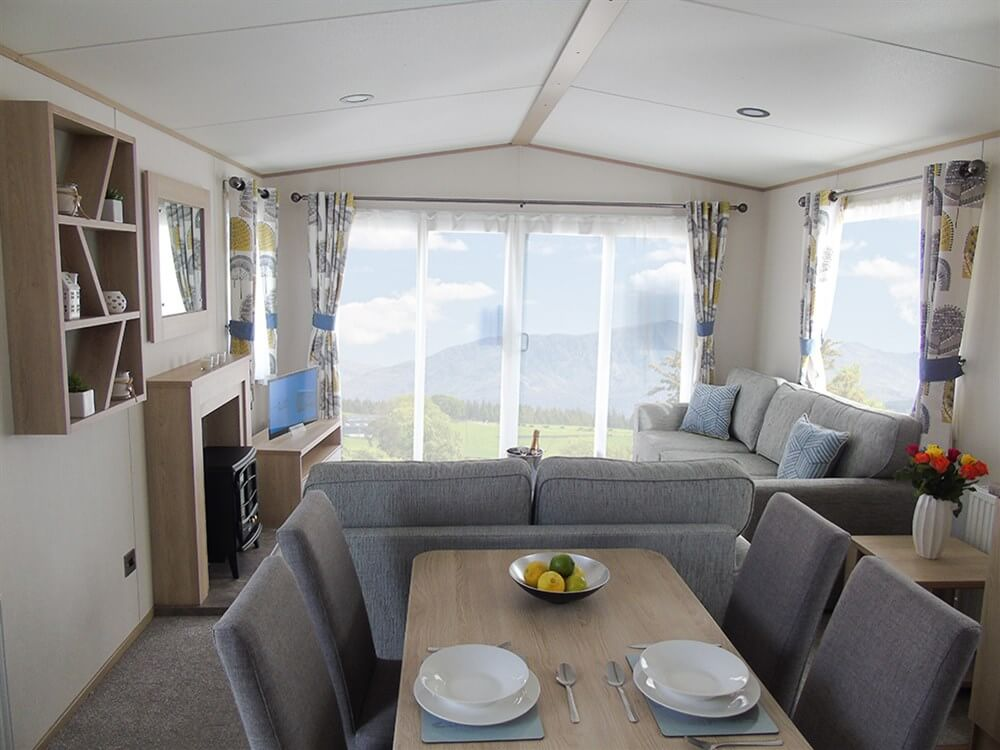 https://silverbay.co.uk/wp-content/uploads/2020/05/1-402-1-18931-1-2020-ABI-Saffron-Static-Caravan-Holiday-Home-lounge.jpg