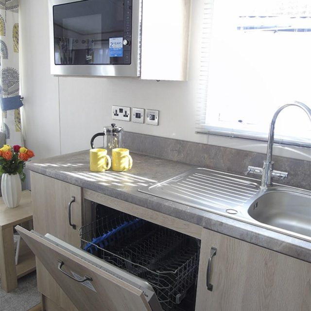 https://silverbay.co.uk/wp-content/uploads/2020/05/1-402-1-18935-1-2020-ABI-Saffron-Static-Caravan-Holiday-Home-kitchen-dish-washer-detail-640x640.jpg
