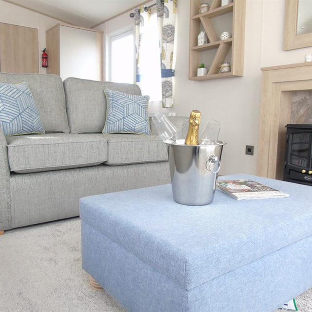 https://silverbay.co.uk/wp-content/uploads/2020/05/1-402-1-18938-1-2020-ABI-Saffron-Static-Caravan-Holiday-Home-lounge-sofa-640x640.jpg