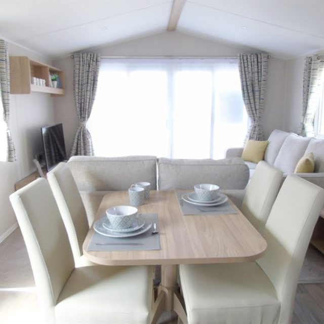 https://silverbay.co.uk/wp-content/uploads/2021/06/1-480-1-20232-1-2021-Willerby-Brenig-Outlook-static-caravan-holiday-home-lounge-overview-640x640.jpg