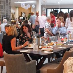 silver-bay-holiday-village-anglesey-the-deck house-people-enjoying-party