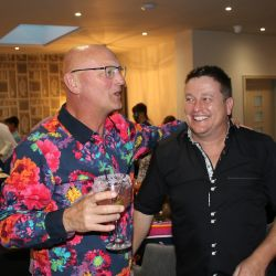 man in flowery summer party shirt
