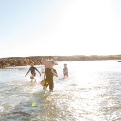 silver-bay-holiday-village-anglesey-busy-bayers-beach-ocean-kids-fun