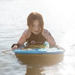 silver-bay-holiday-village-anglesey-busy-bayers-body-board-kid-girl-ocean
