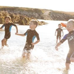 silver-bay-holiday-village-anglesey-busy-bayers-paddling-in-the-sea