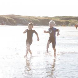 silver-bay-holiday-village-anglesey-busy-bayers-running-in-water