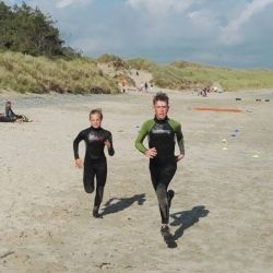 silver-bay-holiday-village-anglesey-busy-bayers-running-on-beach