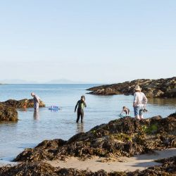 silver-bay-holiday-village-anglesey-family-enjoying-beach-fun-time