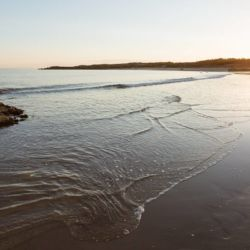 silver-bay-holiday-village-anglesey-sunset-summertime-ocean