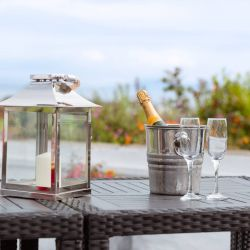 silver-bay-holiday-village-anglesey-the-deck house-bubbly-and-glasses