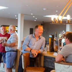silver-bay-holiday-village-anglesey-the-deck house-men-at-the-bar